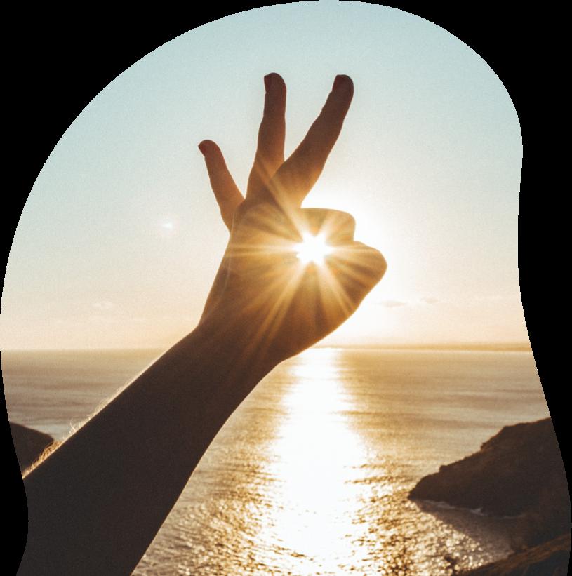 hand met zon - 100% zonnig